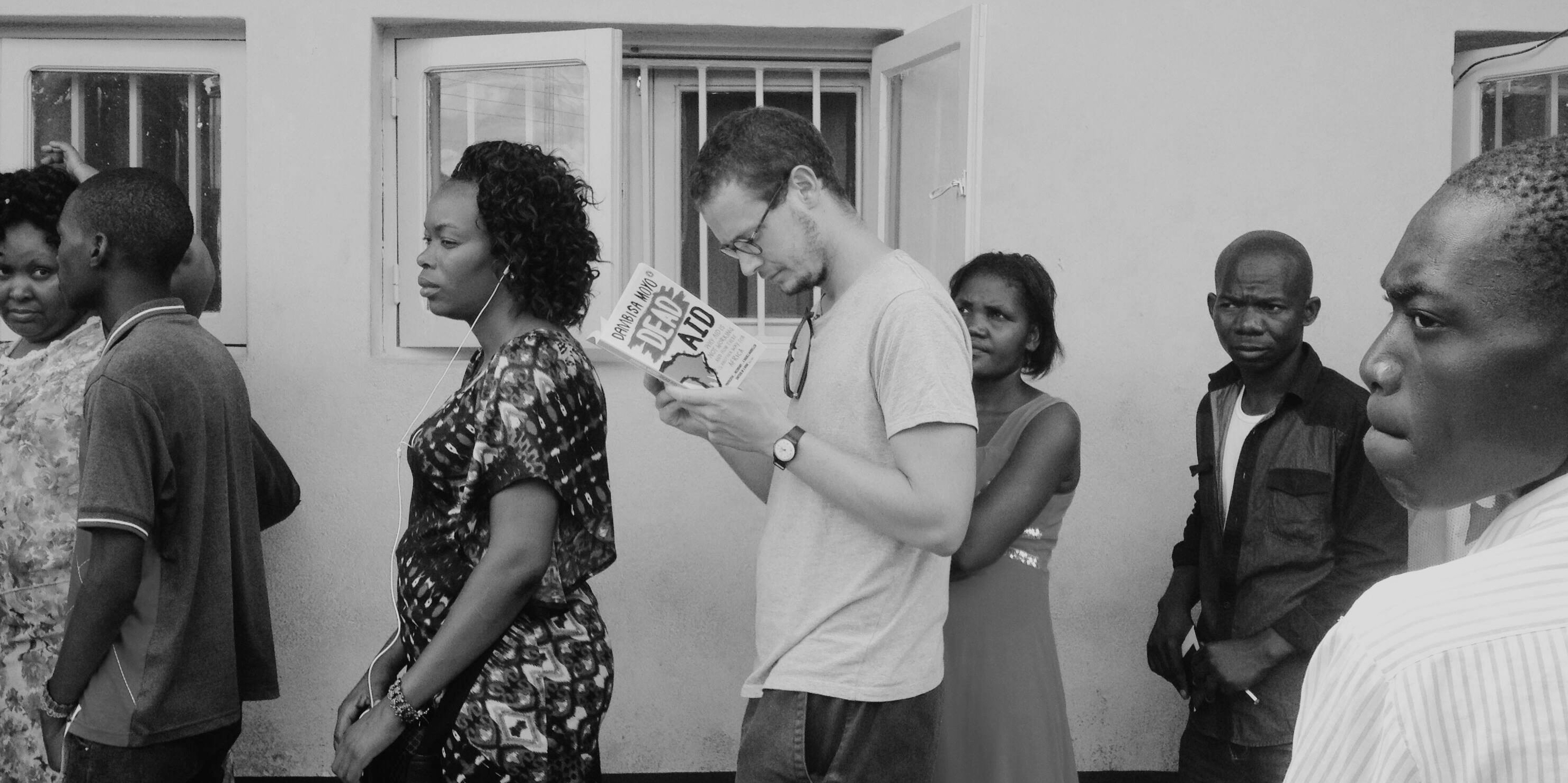 pic of me : alex in malawi border queue bw.png